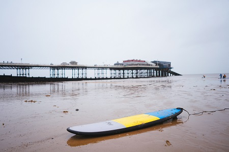 Beach with surfboard